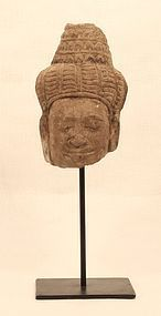 Khmer carved stone head fragment of a male Deity