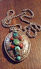Tibetan Silver Repousse Buddhist Pendant with Turquoise and Coral