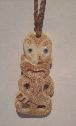 Vintage carved Ox Bone Tiki on waxed cord