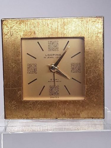 1960s Looping Gilt 8 day 15 Jewel Travel alarm clock