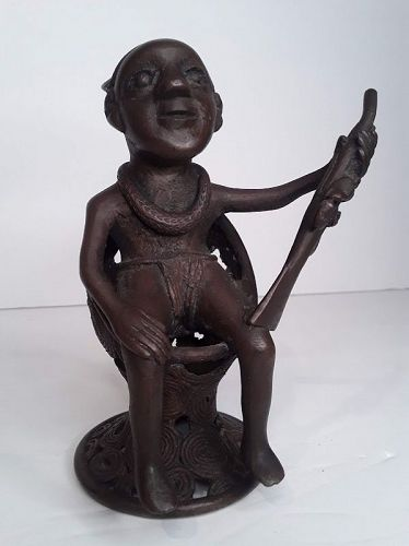 Kongo peoples, Yombe group Copper Bronze seated Oba with Rifle