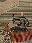 Lovely Small Doll´s Sewing Machine in Store Box