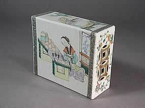 Chinese porcelain headrest with interior scenes
