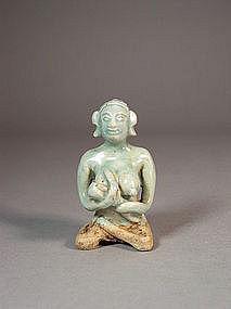 Thai celadon glazed stoneware figurine
