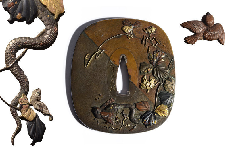 Japanese metal Tsuba with snake and bird made by Iwamoto Konkan