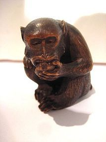 Japanese Meiji Period Boxwood Monkey Eating Netsuke