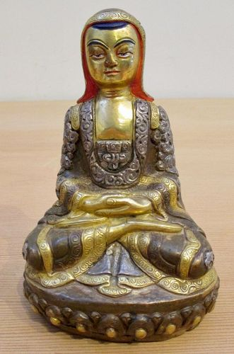 Tibetan Gilt Copper Repousse Seated Figure of Arhat